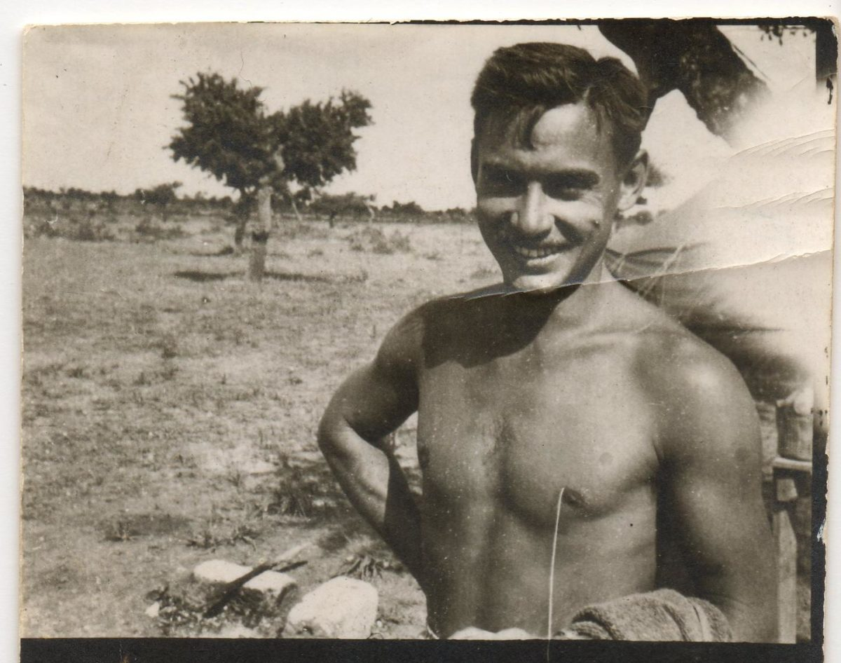 1940s black and white photo of shirtless man