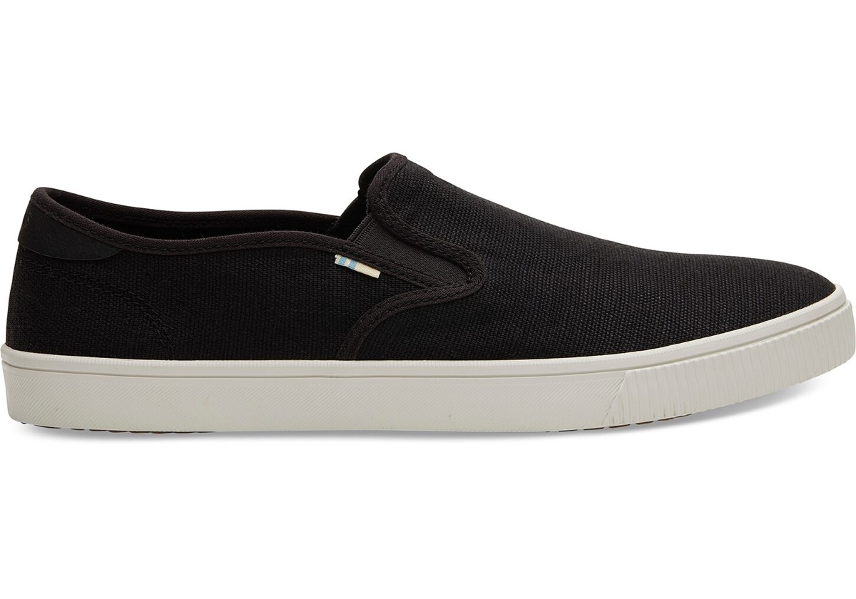black toms sneakers with white soles