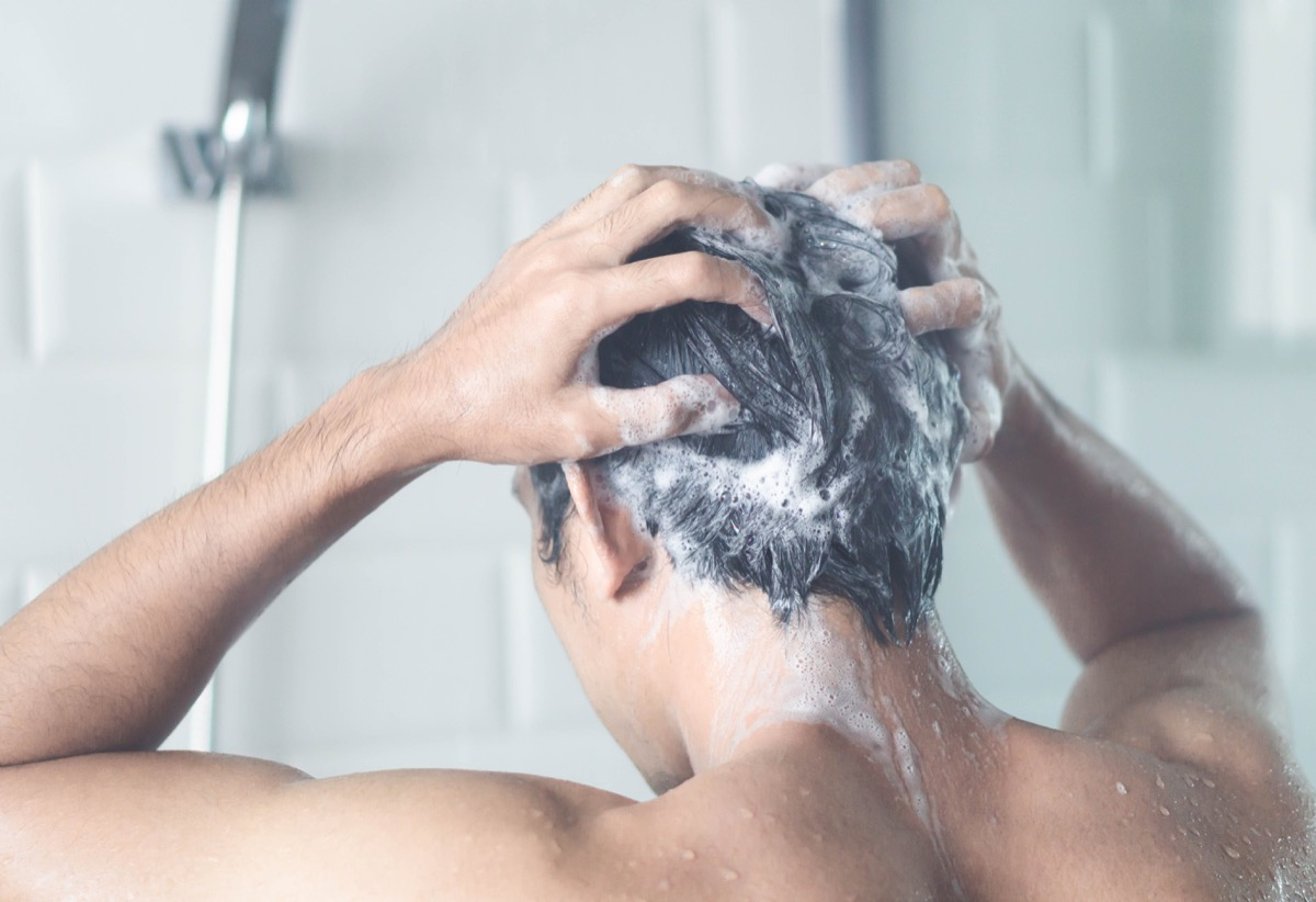 Man shampooing in shower