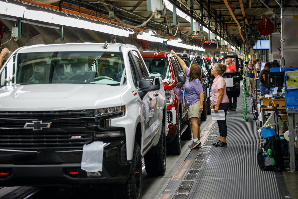 Trucks come off the assembly line at GM's Chevrolet Silverado and GMC Sierra pickup truck plant in Fort Wayne, Indiana, U.S., July 25, 2018.