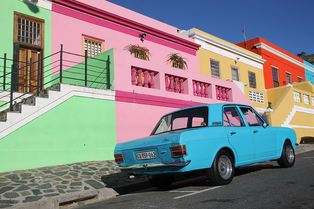colorful street with a blue car in cape town, south africa