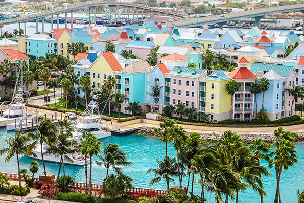 pastel waterfront houses in the bahamas