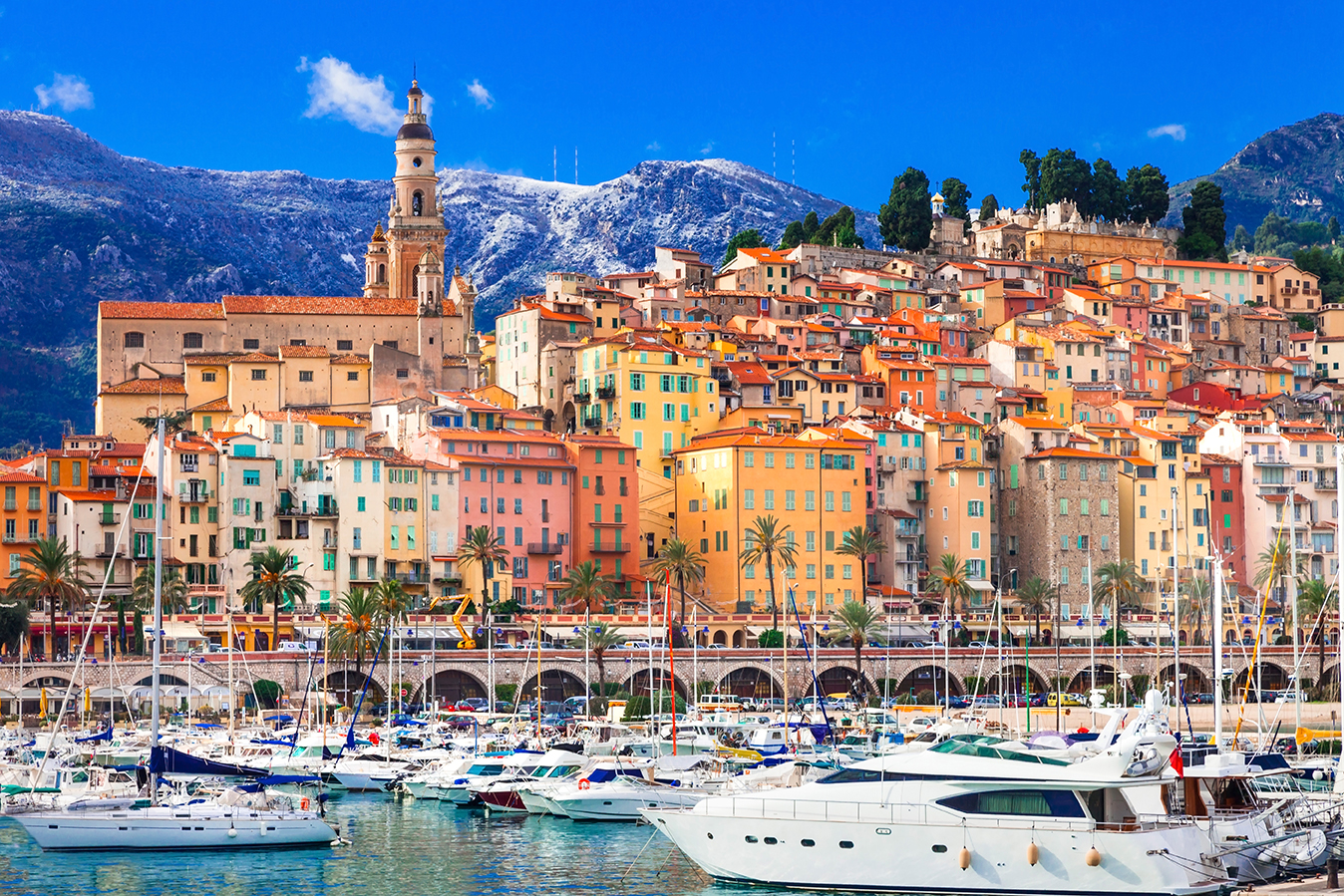 bright yellow and orange buildings in menton, france