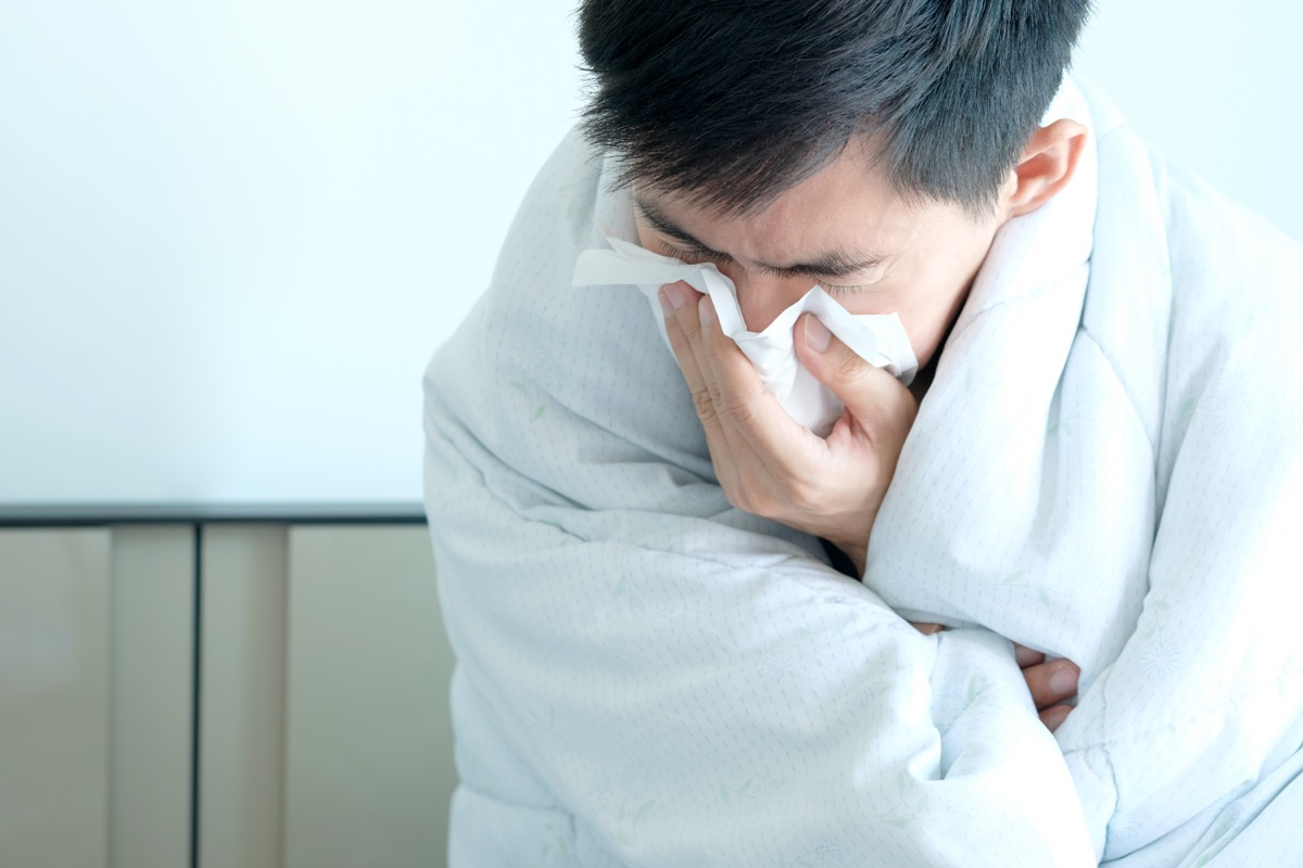 Man blowing his nose sick