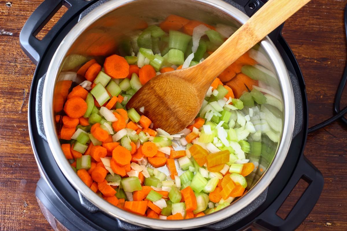 pressure cooker full of chopped vegetables