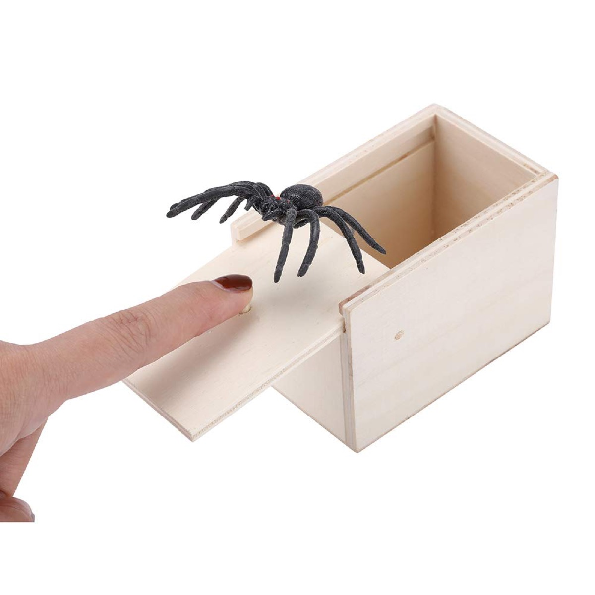 white hand and spider coming out of box