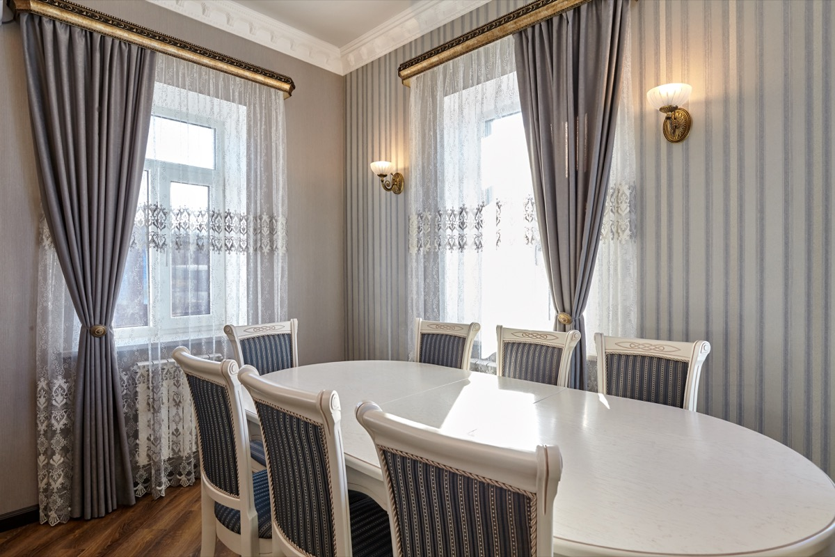 dining room with striped chairs