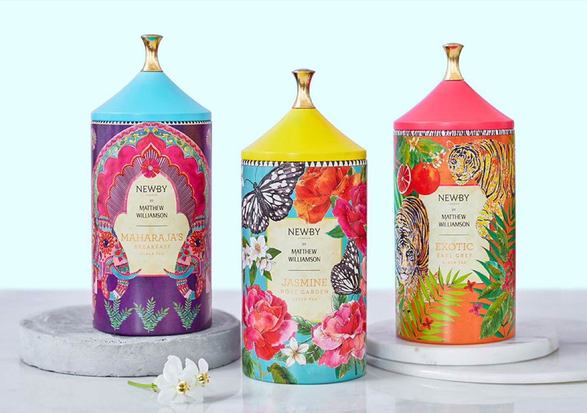 three floral-patterned tea canisters