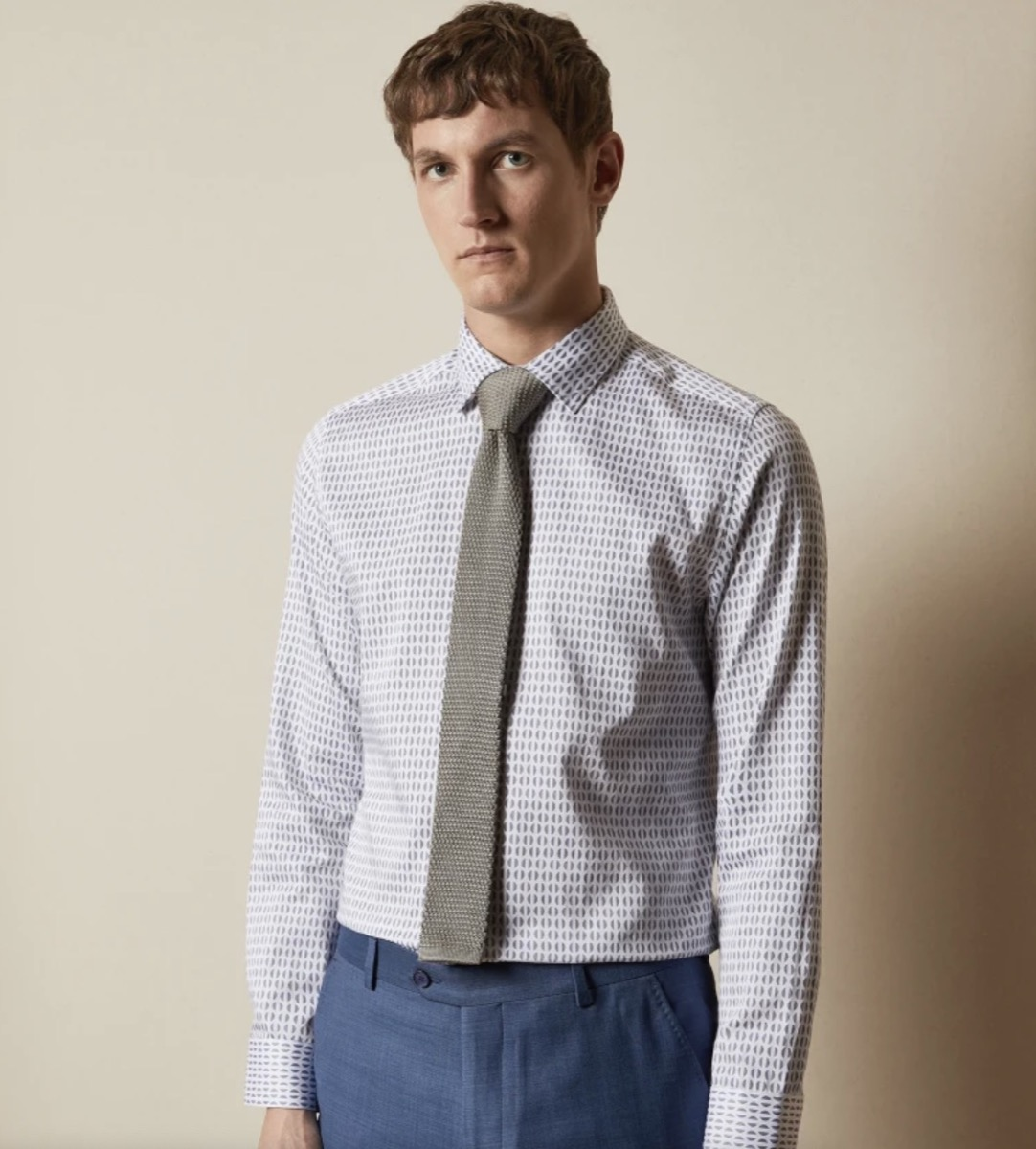 young white man in blue button down shirt and tie
