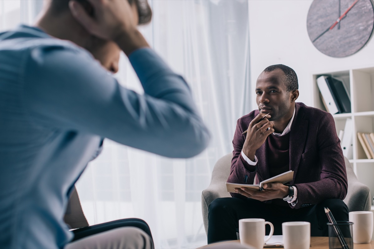 Man talking with a therapist in therapy