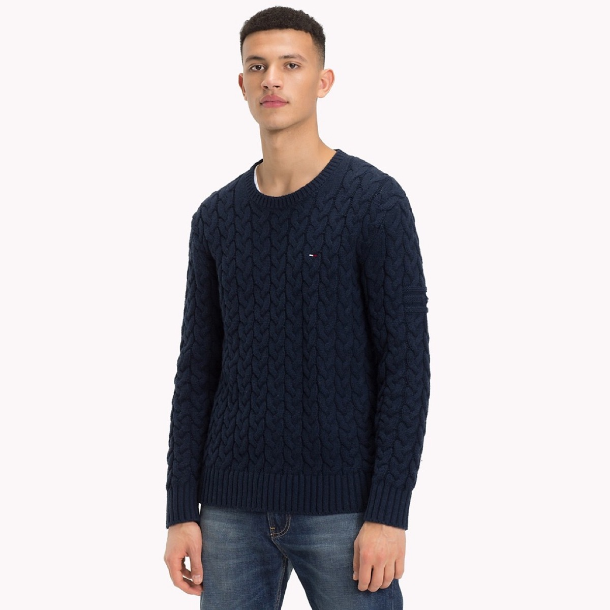 young man in blue sweater