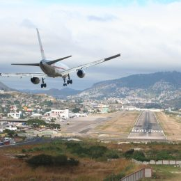 toncontin airport from a bird-eye view with a plane about to land