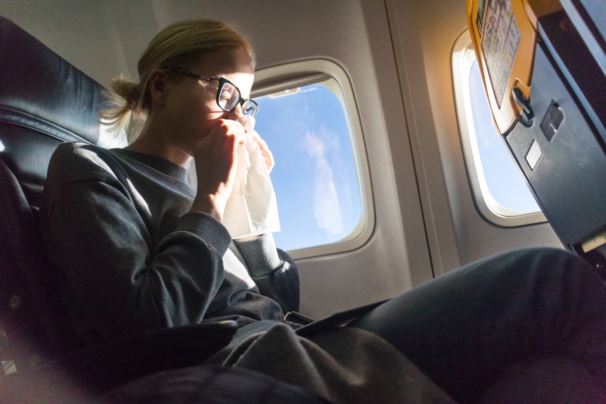 woman traveling while ill
