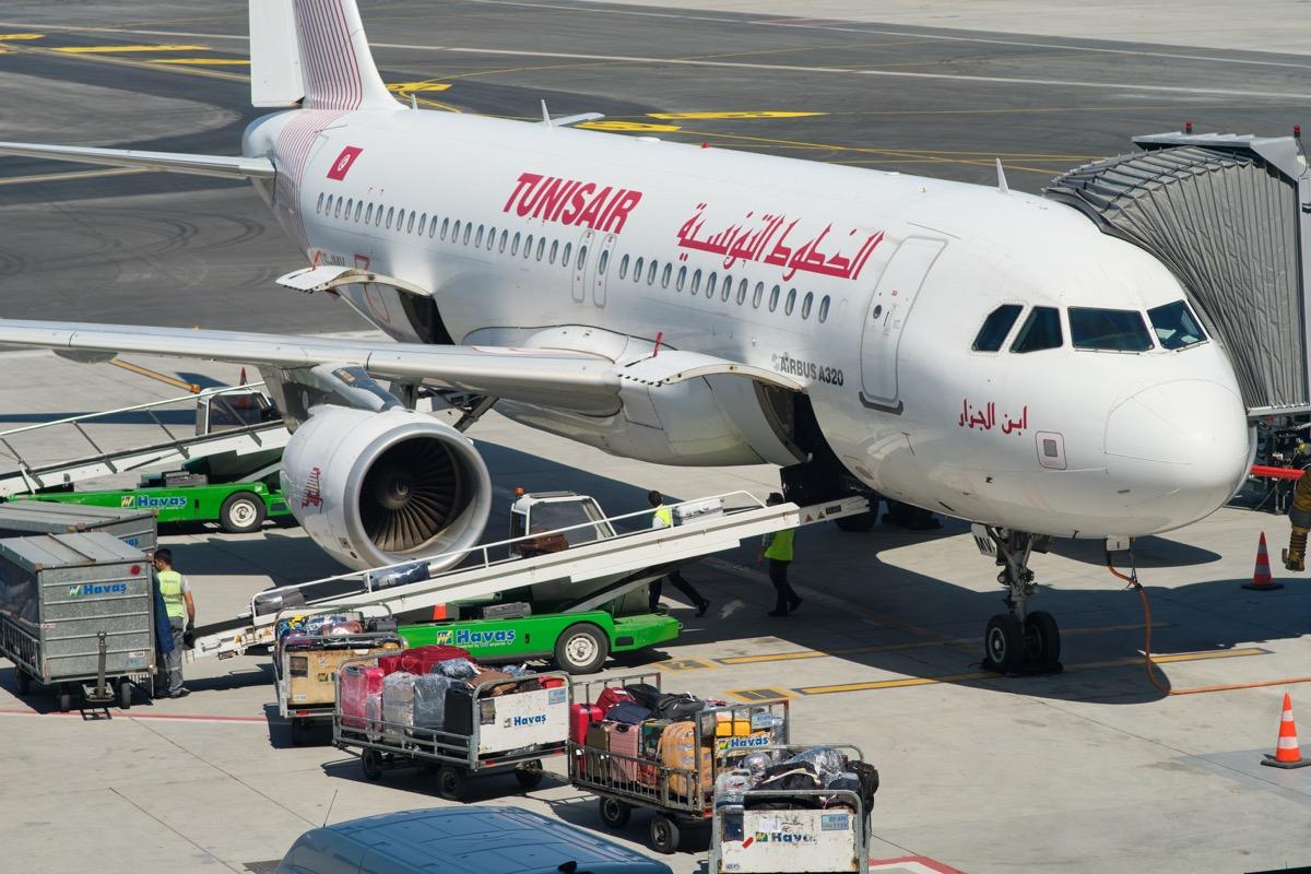 tunisair plane loading cargos