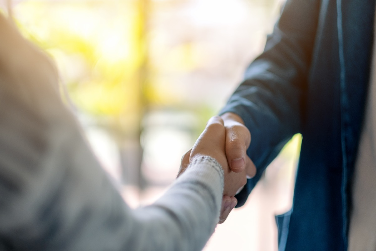 closeup of two adults shaking hands
