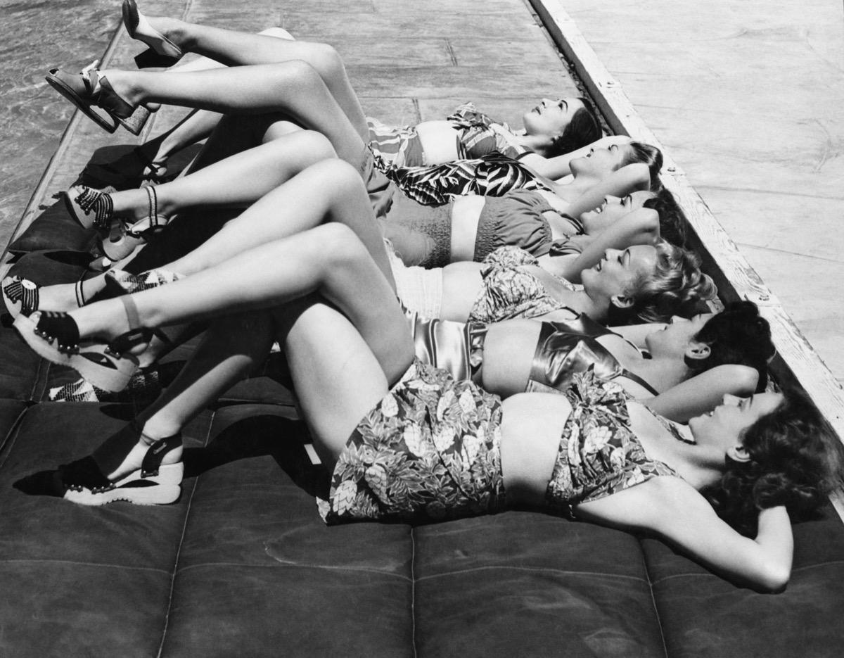line of women sunbathing in 1940s