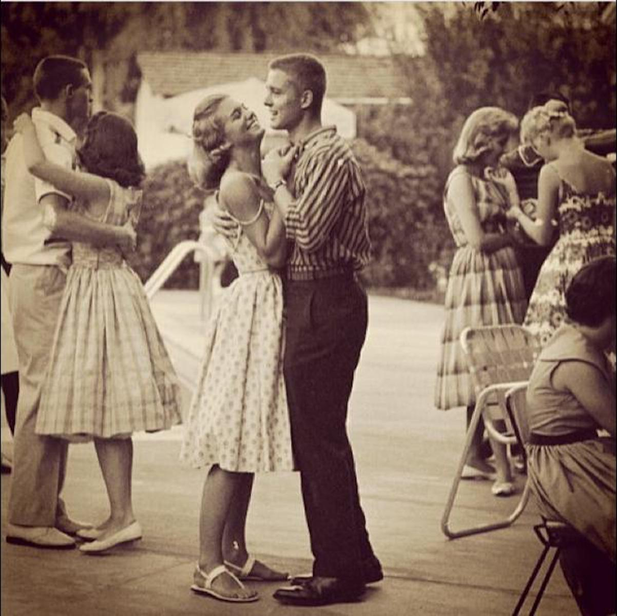 vintage teen couple dancing outside ini 1950s