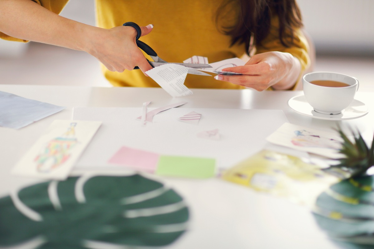 Woman cutting paper to make a vision board