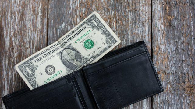 Dollar bill in black wallet