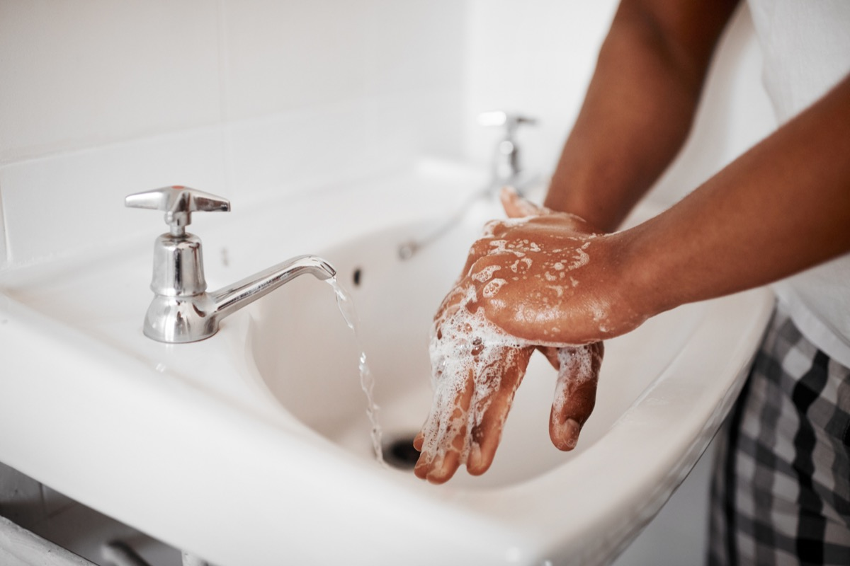 person washes their hands