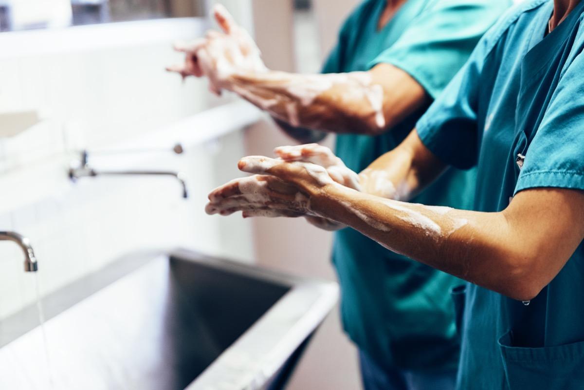 Surgeons nurses washing hands