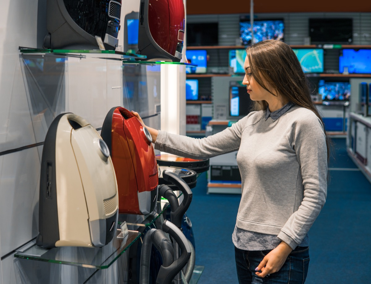 young white woman buying vacuum