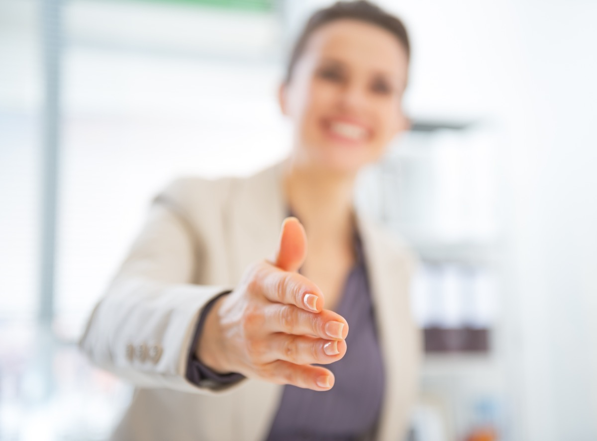 business woman stretching her hand for a handshake