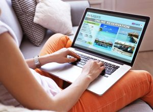 woman making hotel reservation online