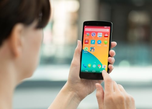 woman using android phone from behind