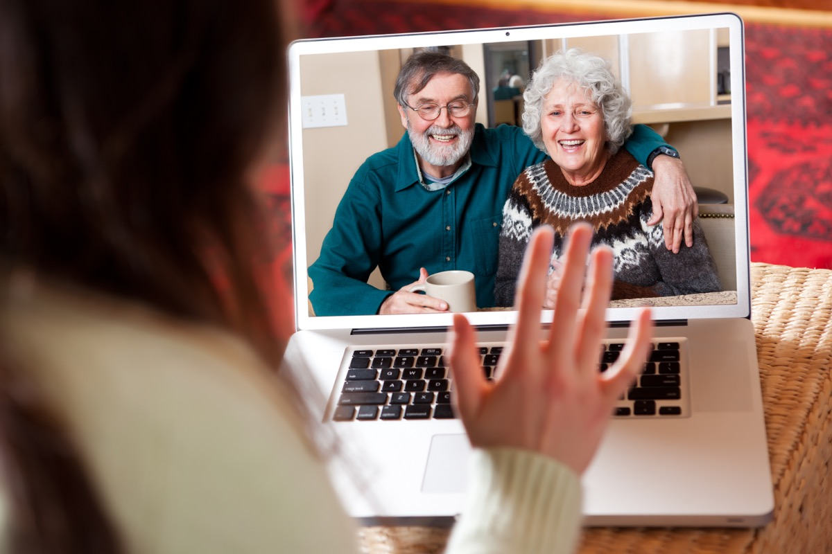 woman video chatting with older white couple