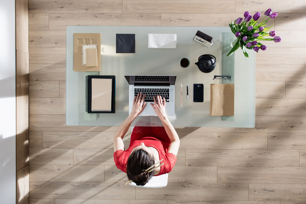 young white woman wfh at organized desk from home office