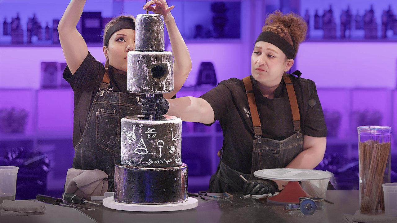 bakers assembling a cake on sugar rush