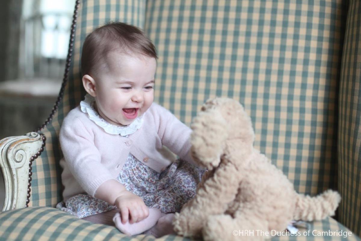 princess charlotte photo with stuffed dog