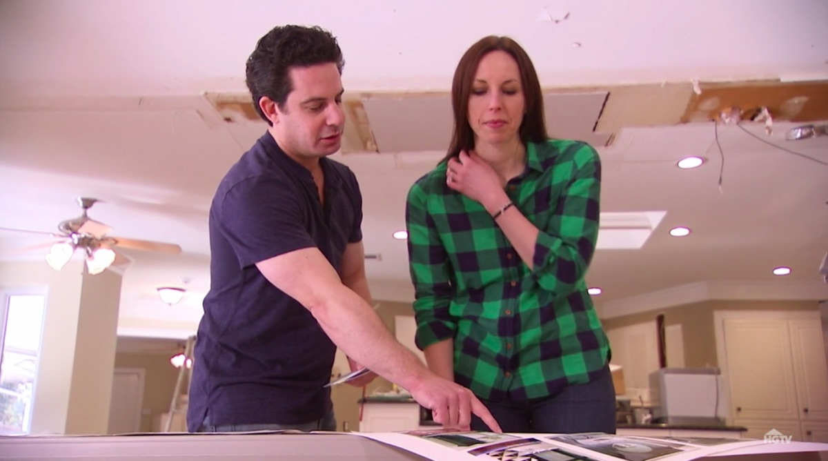 A House Hunters couple looking at their renovation plans