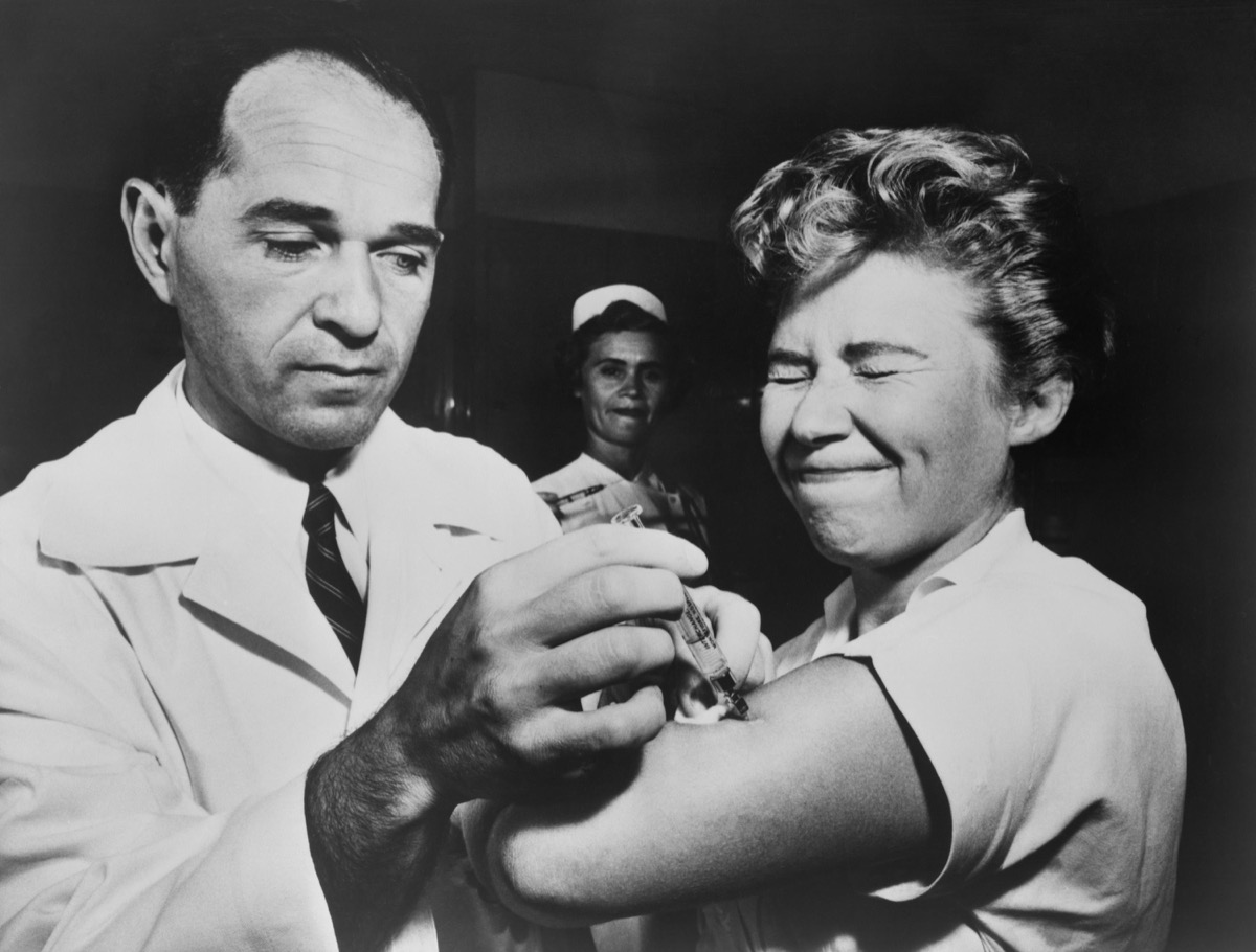Doctor giving nurse flu vaccination