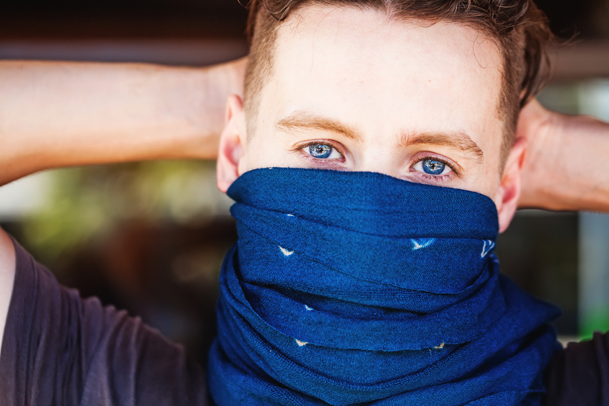 man wears bandana over nose and mouth