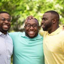Brothers handing out laughing and talking
