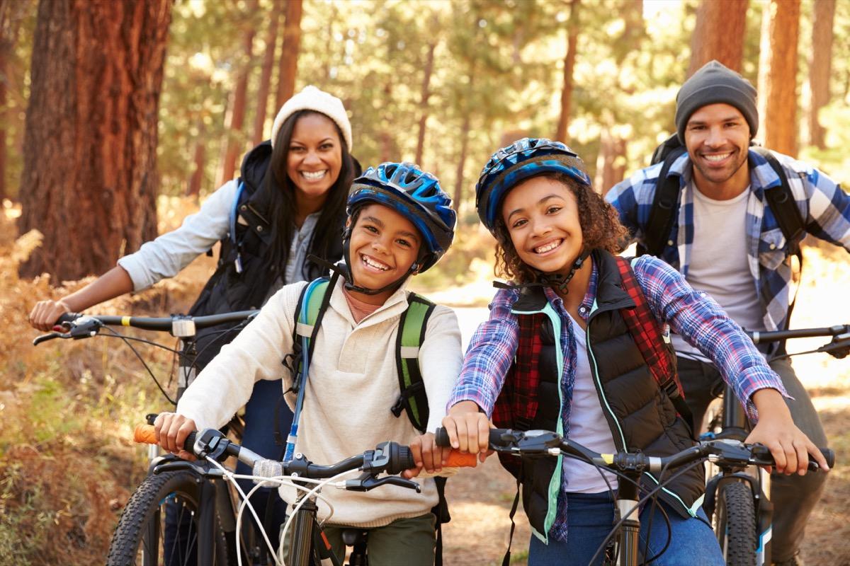 young black family biking