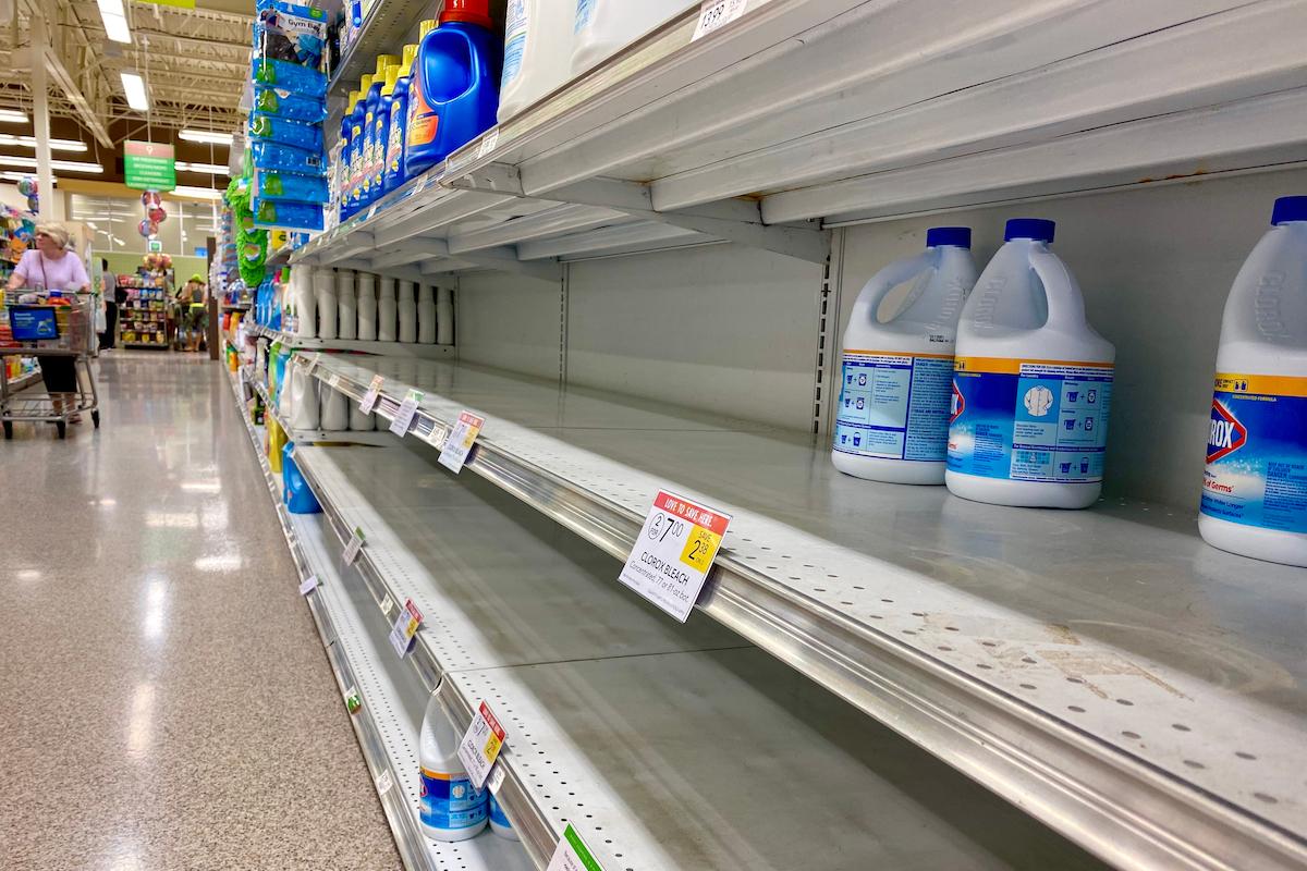 few bottle of bleach left on shelves in super market