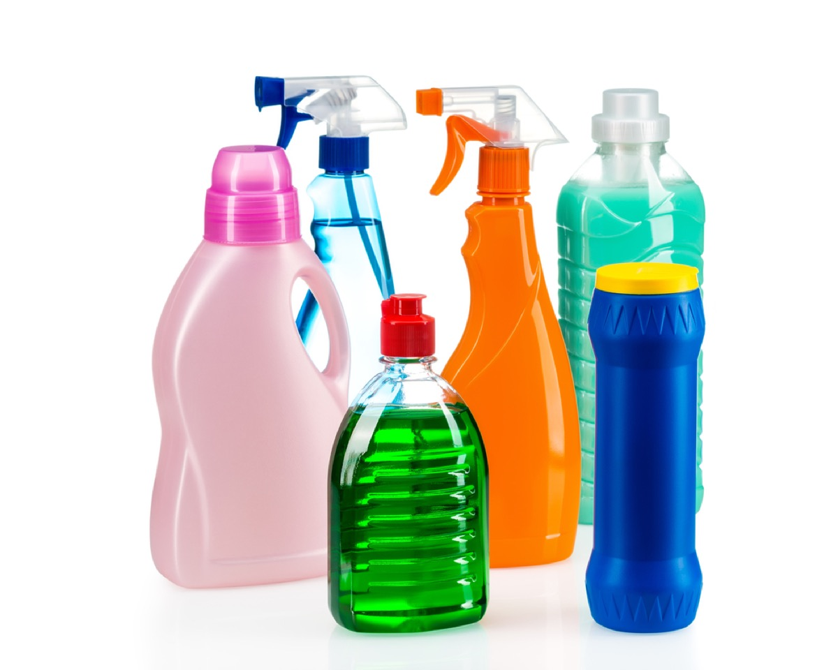 collection of colorful cleaning products in spray bottles and other containers