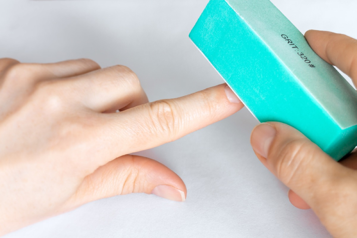 buffing nails with turquoise buffer