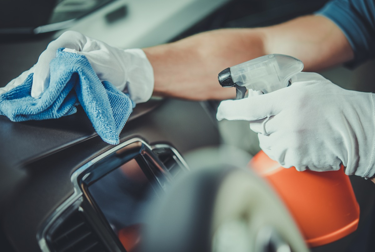 Worker Cleaning Car Dashboard. Taking Care of Vehicle Interior. Automotive Services.