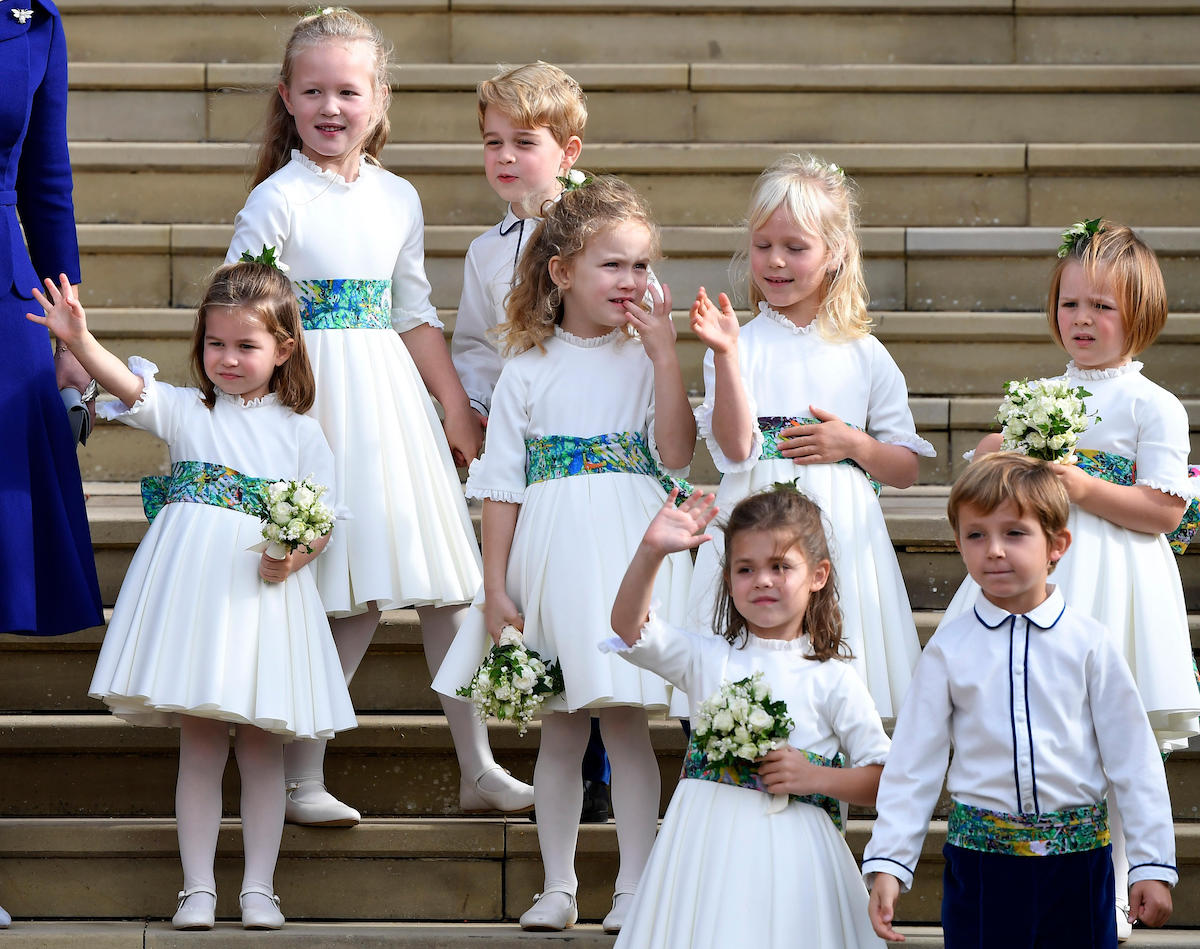 The bridesmaids and page boys, including Prince George and Princess Charlotte, wave as they leave after the royal wedding of Princess Eugenie and her husband Jack Brooksbank at St George's Chapel in Windsor Castle.