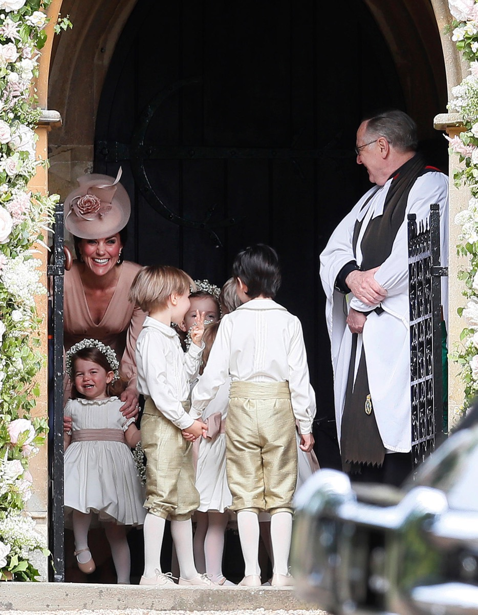 The Duchess of Cambridge, left, stands with her daughter Princess Charlotte, bottom left, as they arrive for the wedding of her sister Pippa Middleton to millionaire groom James Matthews