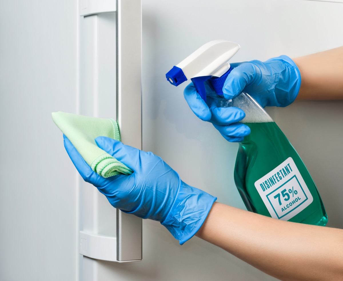 Sanitizing refrigerator handle with disinfectant