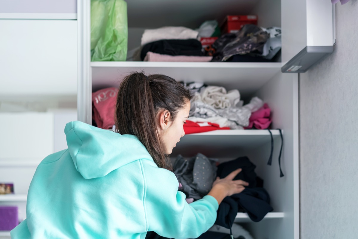 Girl cleaning out closet