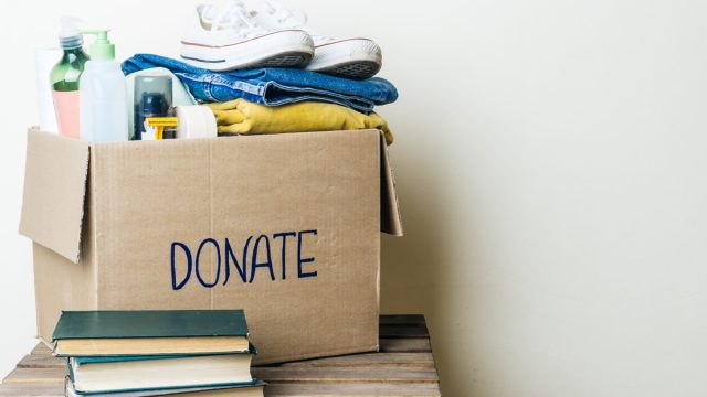 donation box with clothes and hygiene products. Copy space