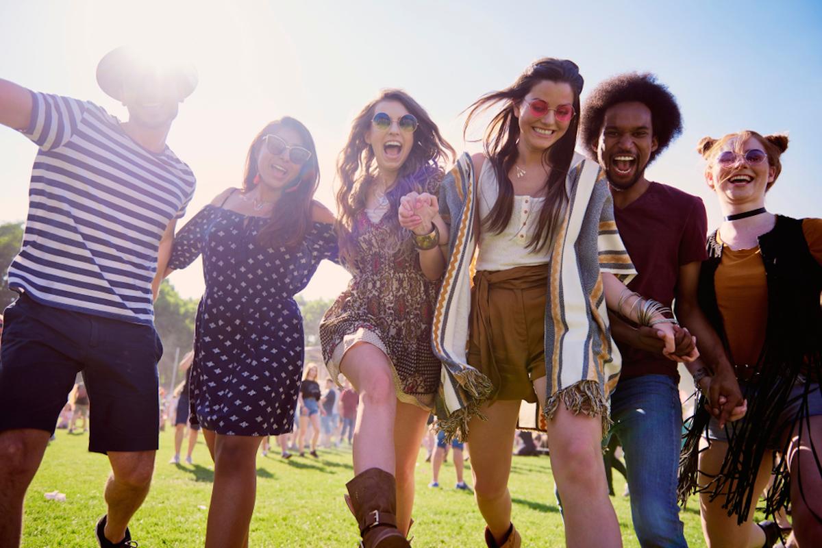 group of friends attend a festival like coachella
