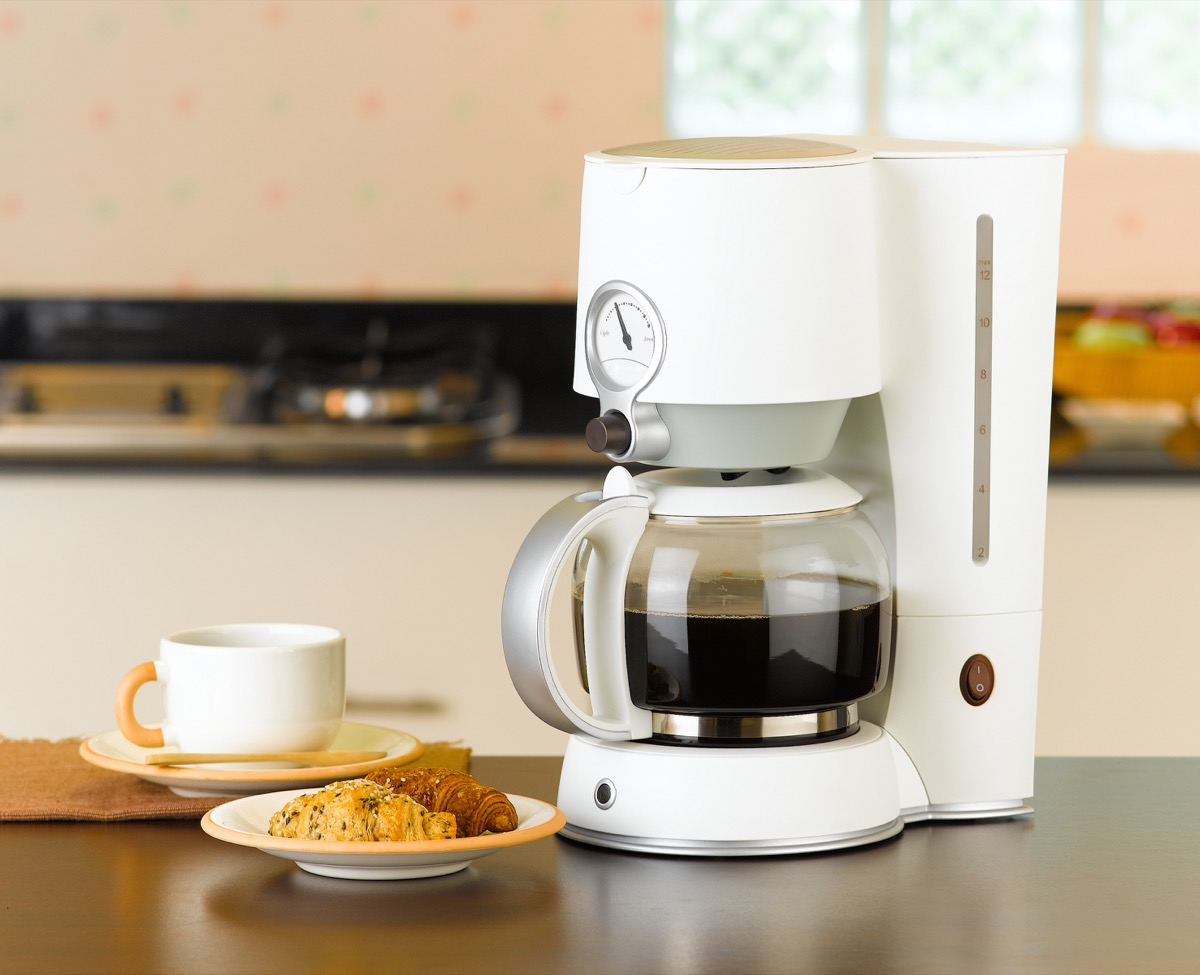 Coffee maker with croissant
