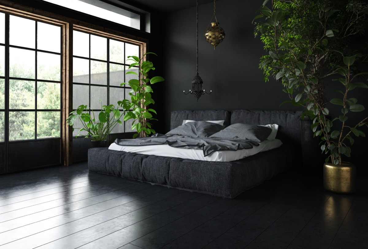bedroom with dark floor and furniture